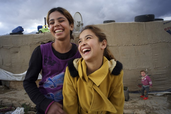 unicef-two-syrian-girls-laughing-696x464